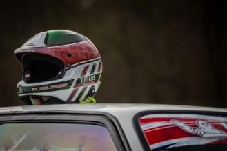 Crash helmet on roof of rally car