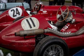 Two red 1940's formula 1 cars