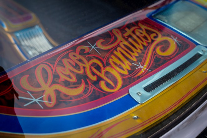 Fancy hand painted lettering on custo car dashboard