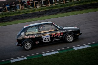 Black hatch back VW Golf race car