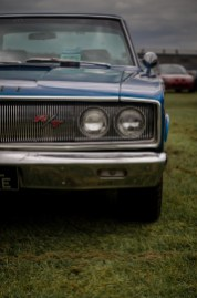 Front grill and lights of blue Doge Charger RT muscle car