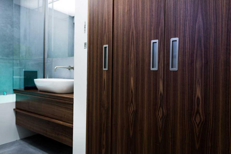 0244 dark wooden bathroom furniture and concrete tiles modern bathroom in North West London