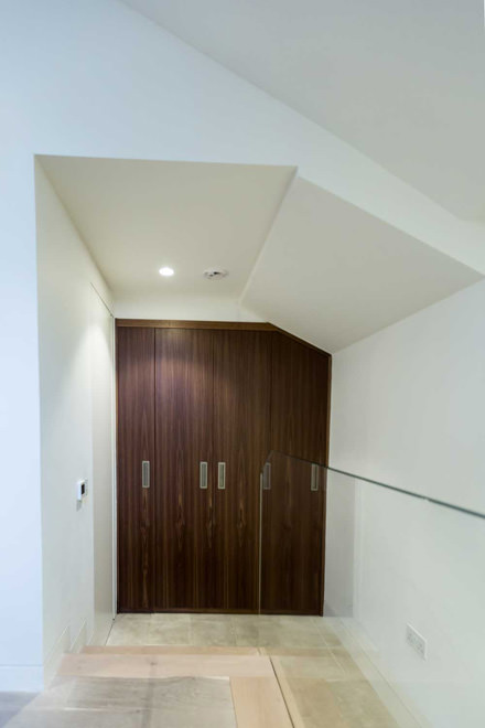 0244 fitted walnut wardrobe under sloped roof in St Johns Wood