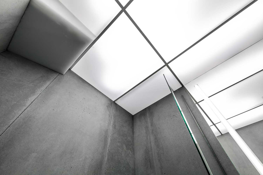 0244 plexiglass white ceiling panels and concrete tiles in bathroom in St Johns Wood