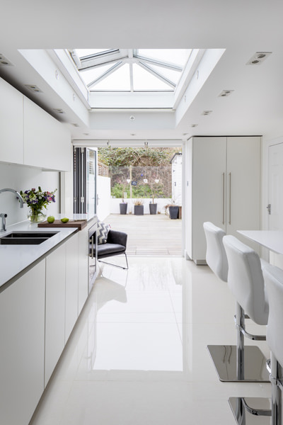 0605 rear kitchen extension in white with folding door and roof lantern