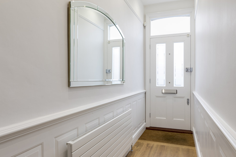 White entrance hallway with wall panels Latimer Road London