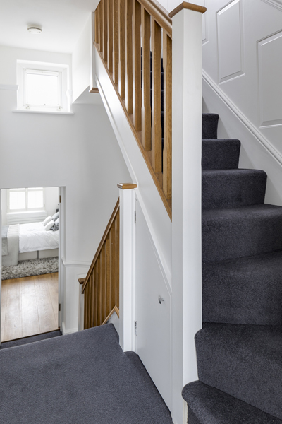 0605 white and wooden stairs with grey carpet in north kensington