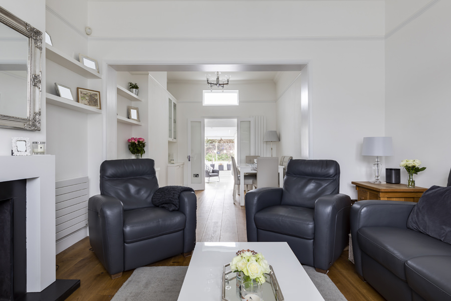 0605 dark leather living room furniture white walls oak floor north kensington