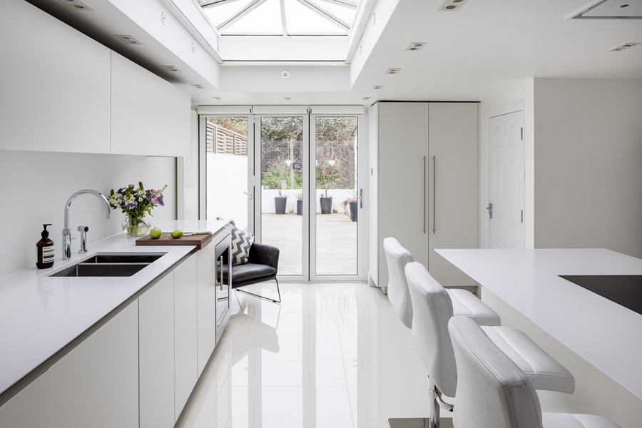 0605-kitchen extension white tiles high gloss cabinets and roof lantern in London