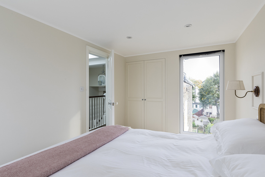 0631 loft conversion bedroom with full height window and storage
