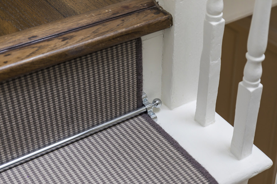 0631 dark wood staircase with white steps and brown stripes carpet runner in London