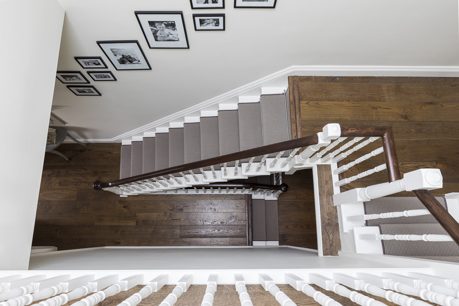 0631 dark wood staircase with brown stripy carpet runner and white balustrade