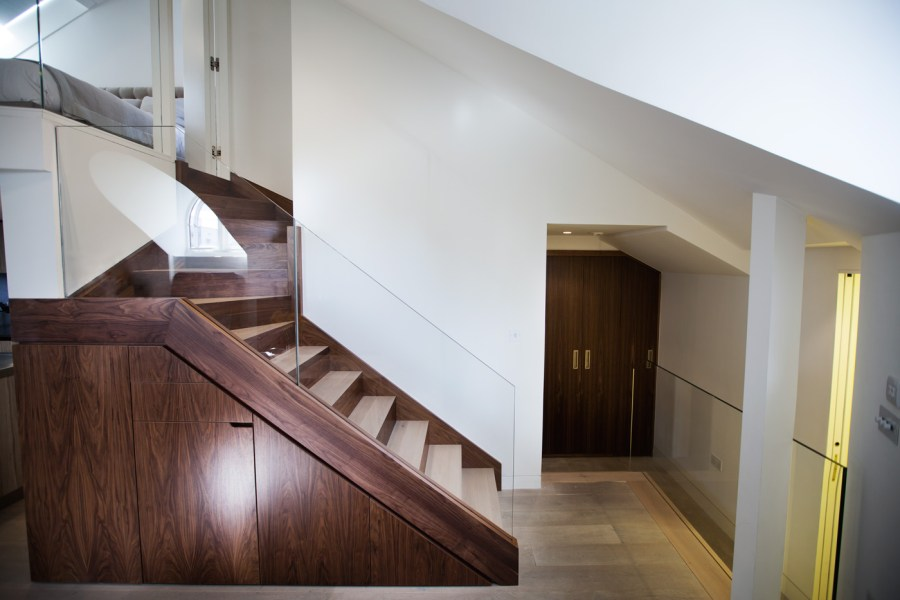 0244 dark oak staircase to mezzanine with glass balustrade modern interiors in North West London