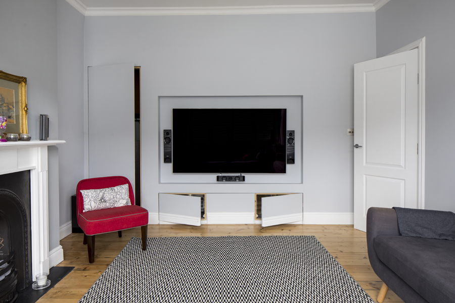0557 TV wall with built in media unit and concealed storage in south west london