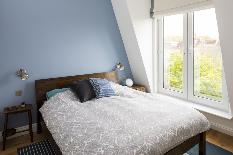 0557 loft bedroom with mansard roof and blue wall