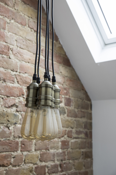 0557 industrial light bulbs pendant and exposed bricks wall in south west london
