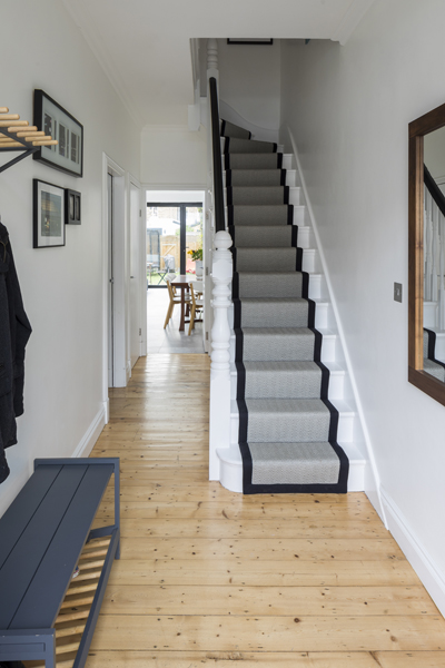 0557 terraced house entrance hallways and white stair with grey pattern carpet runner in wimbledon