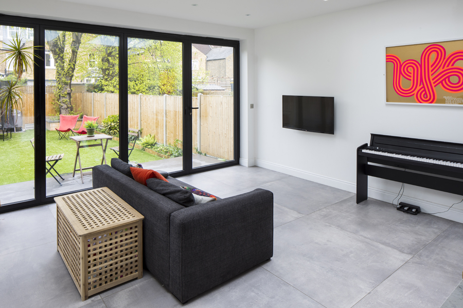 0557 piano grey sofa and bifolding glass door in rear extension
