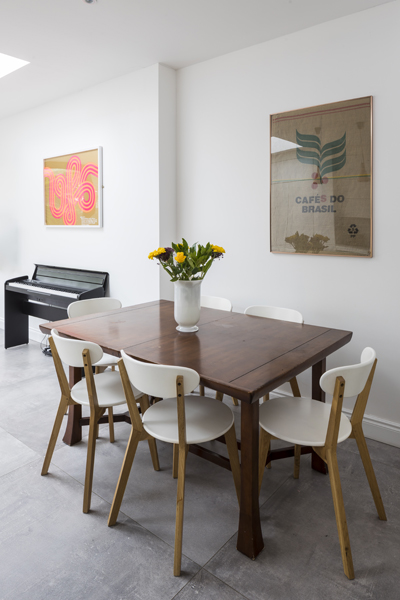 0557 dining area in a kitchen extension with wooden table and white chairs in london
