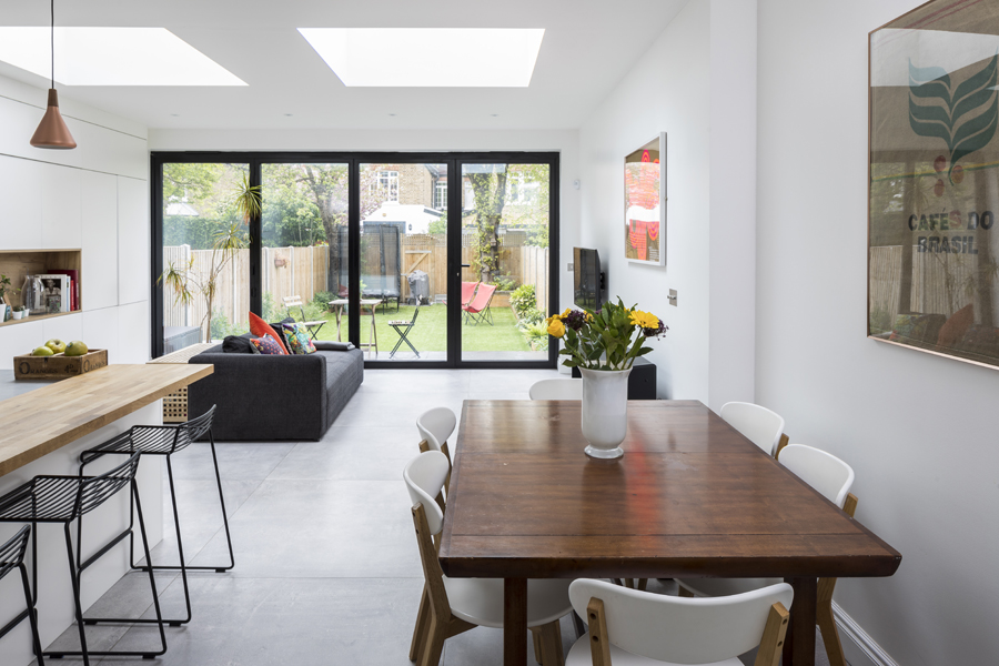 0557 modern kitchen extension with concrete tiles and bifolding glass doors in wimbledon