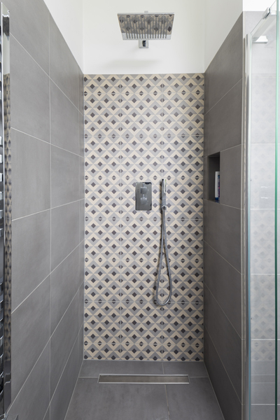 0557 shower with grey concrete tiles and pattern feature wall in london