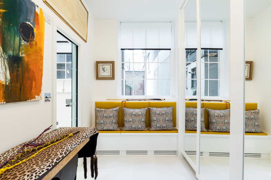 0587 dressing room with mirrored high gloss white wardrobe and yellow window seat
