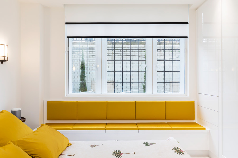 0587 Crittal window with white and black blinds yellow window seat in Portland Place