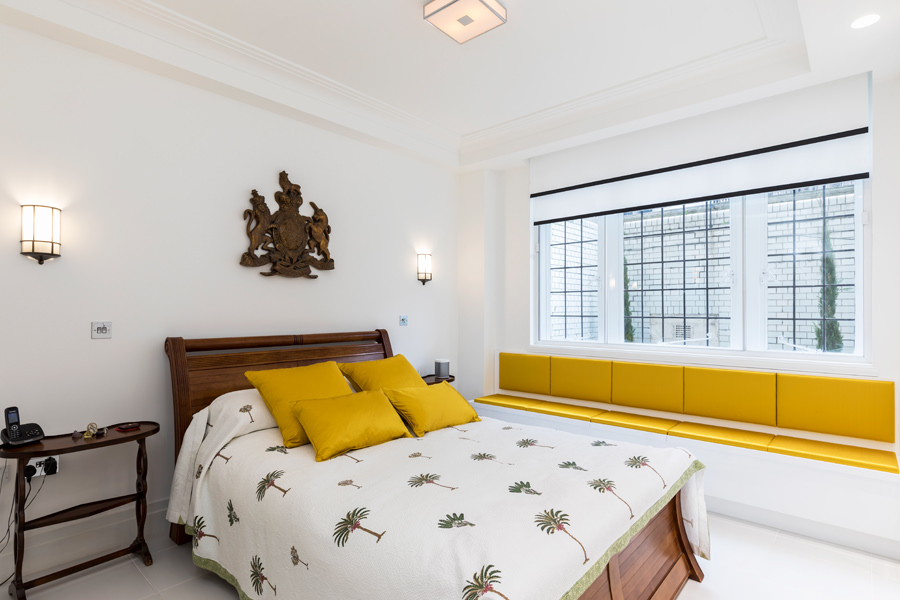 0587 wooden frame bed in master bedroom and yellow window seat