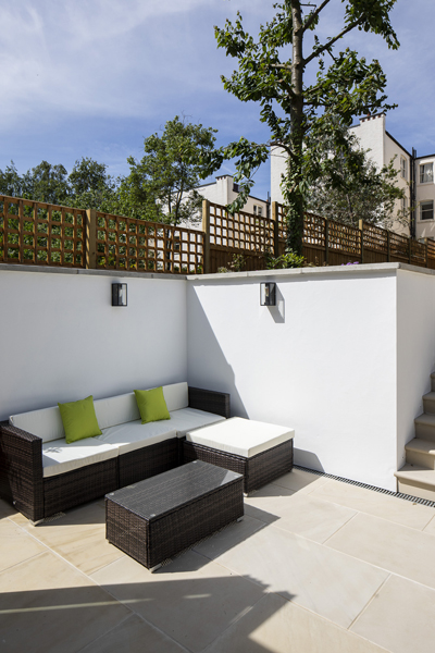 0776 secluded patio garden corner with outside sofa in North West London garden