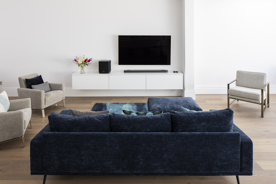 0776 living area in the back extension with blue sofa and wall mounted TV unit