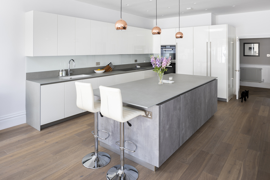 0776 white high gloss kitchen units and grey island with leather bar stools and copper lights