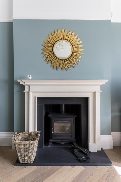 0776 white fireplace with chesney stove and blue wall in london nw6