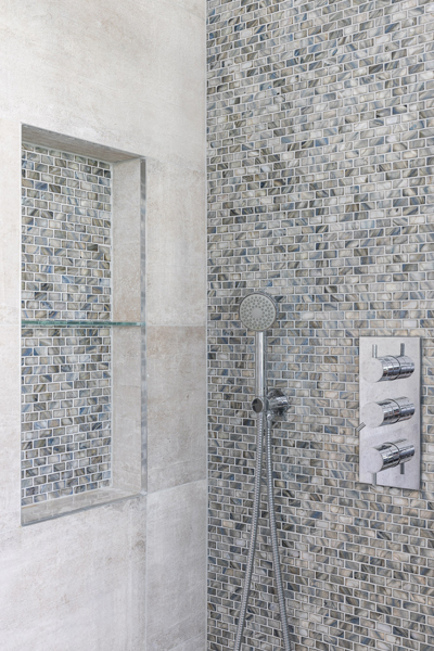 0776 shower with grey stone and mosaic tiles niche