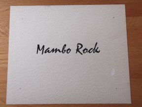 Titelkaart met handlettering van Jan van der Does. Mambo Rock is de titel van een hit van Bill Haley and his Comets uit 1955. Collectie Jan van der Does
