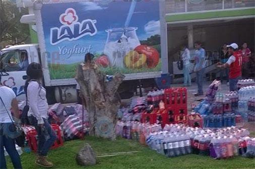 Presuntos normalistas saquean camiones de diversas empresas