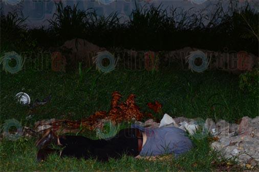 Hallan cadáver sobre un camino de terracería