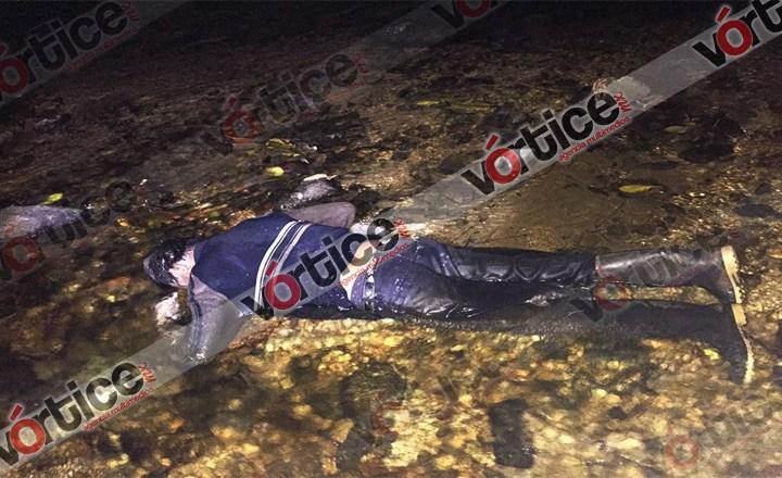 Localizan cadáver de un campesino sobre un arroyo