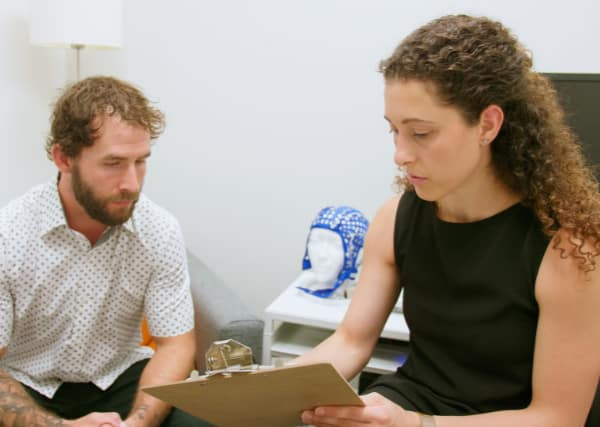 woman showing report to man