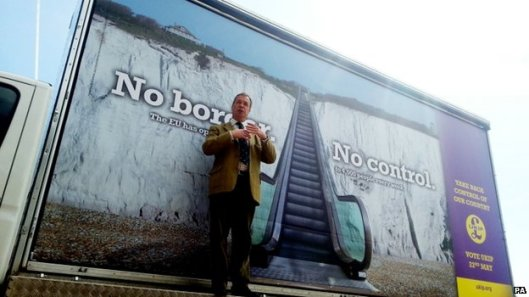 No control: Nigel Farage in front of one of his party's anti-immigration posters. He says he doesn't hate foreigners; judge for yourself. [Image: BBC]