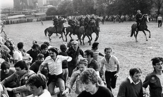 Striking miners flee a charge by mounted police at Orgreave coking works in south Yorkshire in 1984 [Image: Rex].