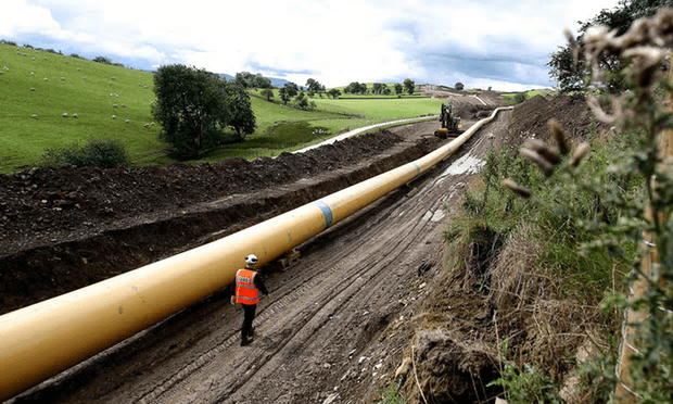 An engineer walks along stretch of National Grid gas pipeline near Skipton in North Yorkshire [Image: Nigel Roddis/Reuters].