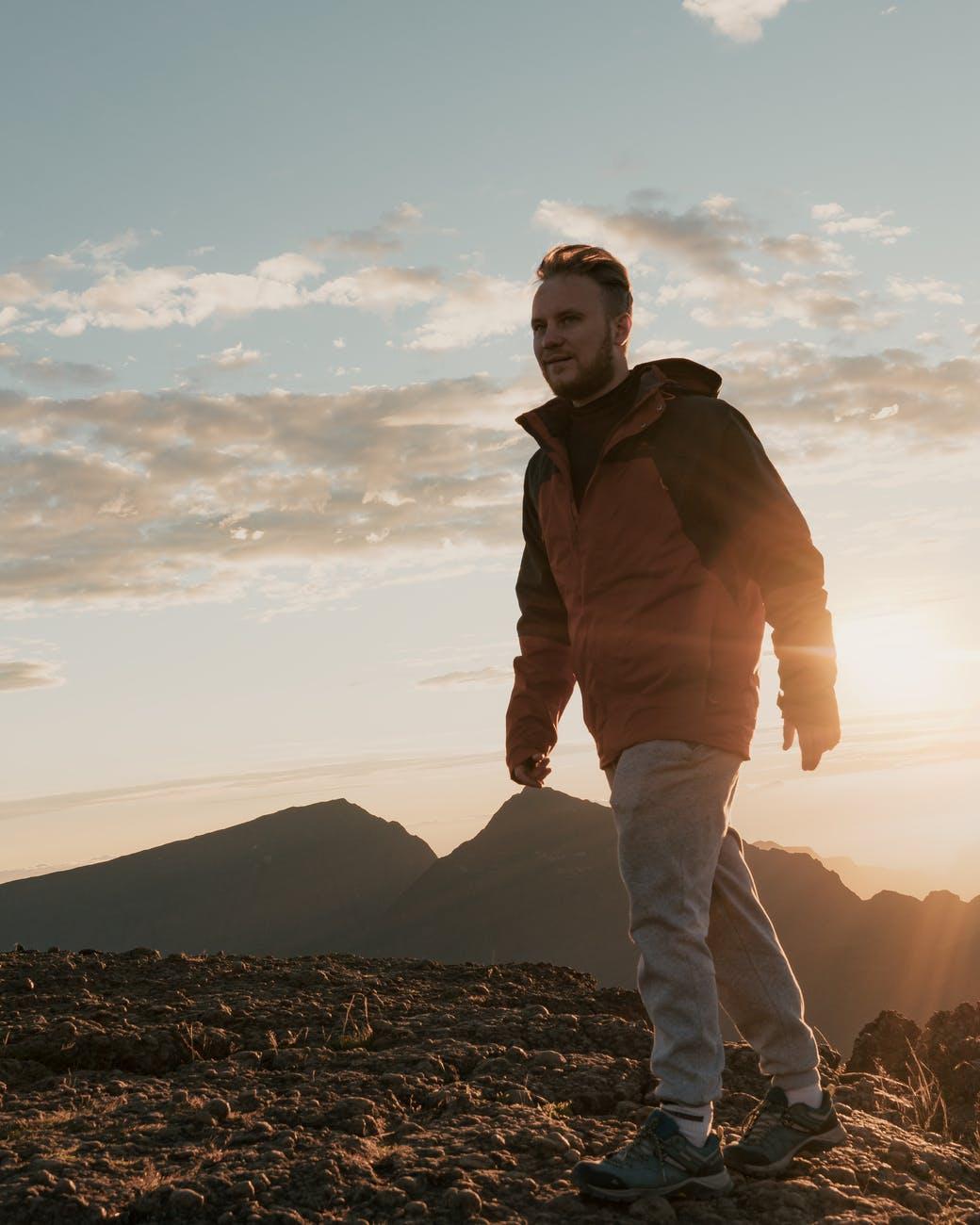 man standing near brown ground