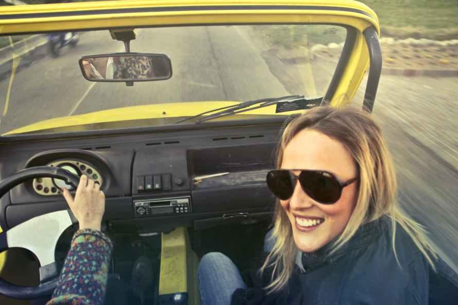 woman in black aviator sunglasses sitting on car s passenger seat