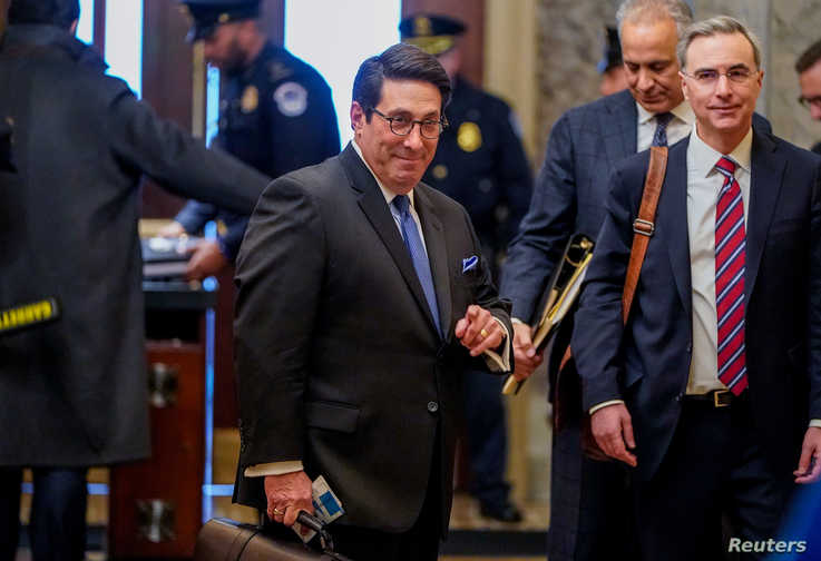 U.S. President Donald Trump's personal attorney Jay Sekulow and White House counsel Pat Cipollone pass through security as they…