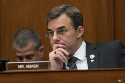 Rep. Justin Amash listens during a House committee hearing on Capitol Hill in Washington, June 12, 2019.