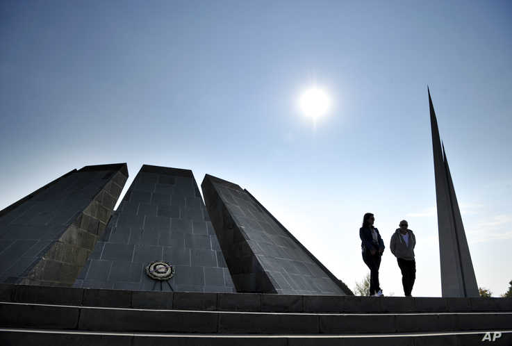 A couple walk at the Tzitzernakaberd memorial to the victims of mass killings by Ottoman Turks, in the Armenian capital Yerevan…