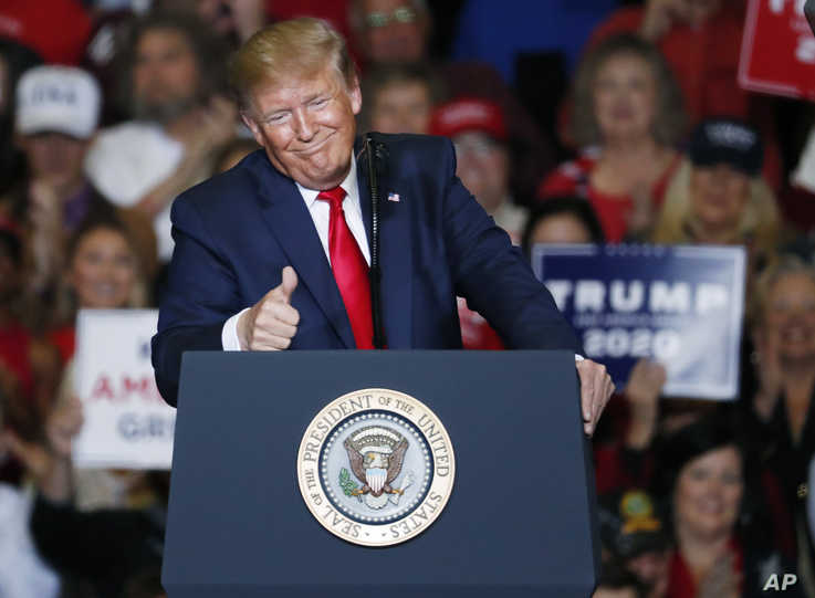 President Donald Trump gestures to the audience during his address on a number of topics, including his administration's…