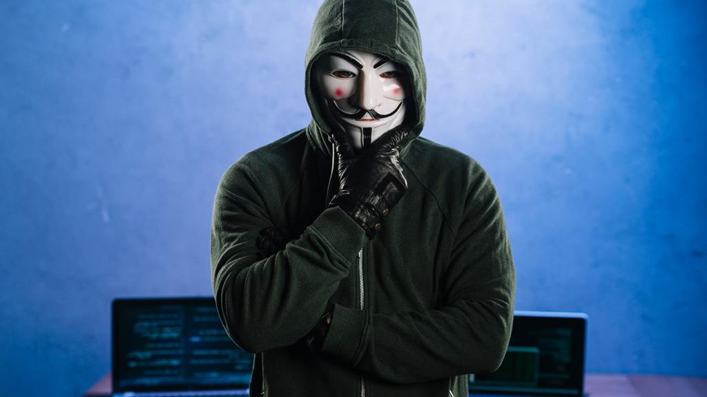 Image of an anonymous person with laptops