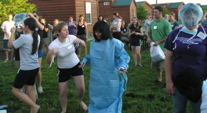 """Annie Chih is the model in the """"dress your partner in PPE"""" Science Olympics event at Worlds of Fun amusement park in Kansas City with scholars from the Oklahoma State and Kansas State VRSPs."""