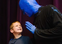 Blue Man Group member with autistic child